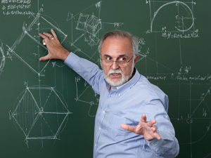 Teacher explaining something on a blackboard