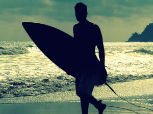 Surfer with ocean behind him